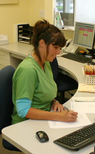 Lisa filling out patient paperwork